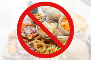 fast food, low carb diet, fattening and unhealthy eating concept -close up of fast food snacks and cola drink behind no symbol or circle-backslash prohibition sign